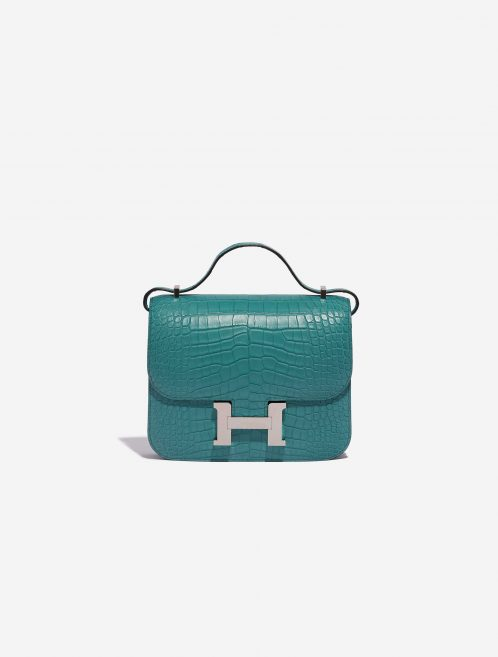 """An exotic Hermès Constance 18 designed for seamless day-to-night dressing. It has been handcrafted from exquisite, matte alligator leather in Blue Paron topped with palladium-plated hardware. Produced in 2020 (""""Y"""" stamp), it arrives in immaculate unworn condition. Make it the jewel in your bag collection."""